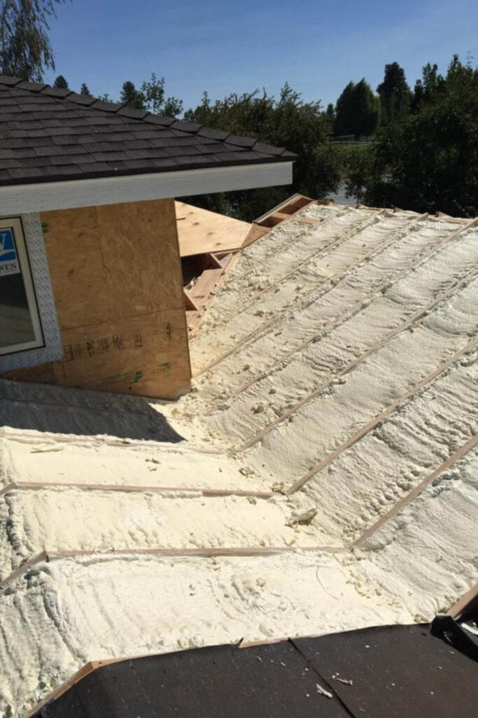 Residential construction roof spray foam insulation